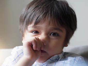 child boring his nose